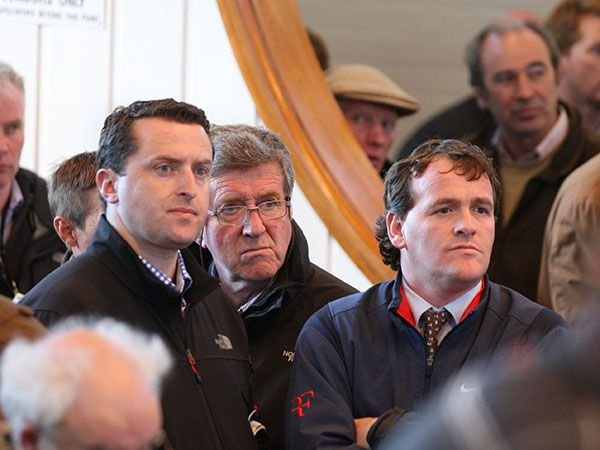 Trainer Richard Hannon flanked by Peter and Ross Doyle