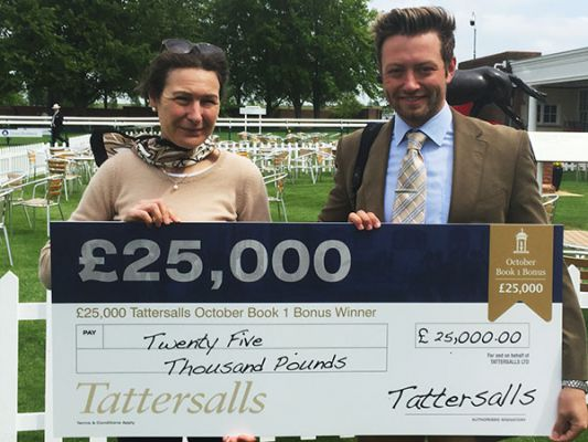 Assistant trainer Charlie Johnston Accepts the £25,000 'Book 1 Bonus' Cheque