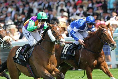 PROHIBIT (Left) winning the G1 King's Stand Stakes