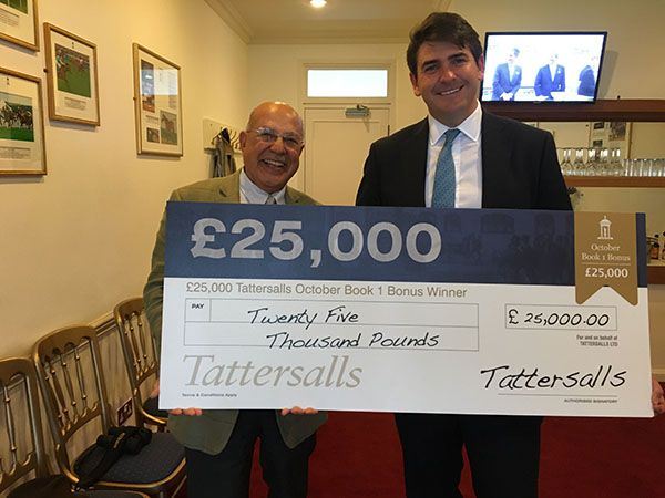 Purchaser Tony Nerses and trainer Hugo Palmer with cheque for £25,000