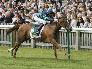 Finsceal Beo Winning the Group 1 1000 Guineas