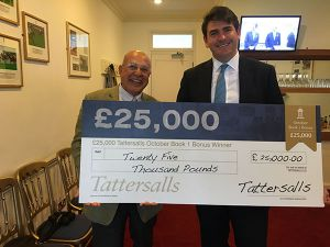 Tony Nerses and Hugo Palmer with a cheque for £25,000